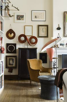American tribal art dealer Kevin Conru and his English wife Anna live in a grand early 20th century town house, by architect M. Karsoul in the centre of Brussels with their 2 young sons.