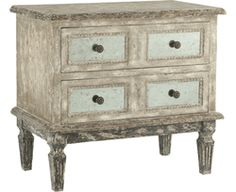 Distressed with mirrored drawer fronts. Beautiful.
