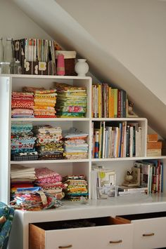 Making full use of angled ceilings~ paint the cheap bookshelf downstairs black & use upstairs for fabric & such? YES!!!