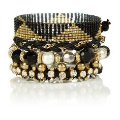 Black and Gold Beaded Friendship Bracelet Stack ($4.22) ❤ liked on Polyvore featuring jewelry, bracelets, accessories, stackers jewelry, bead jewellery, beaded bangles, stacking bangles and beading jewelry