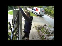 FedEx delivery man caught on video tossing a computer monitor over a fence