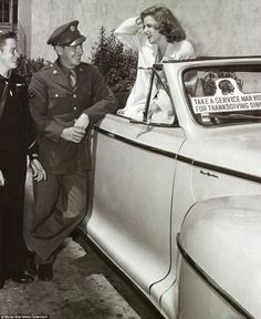 """""""Take A Serviceman Home for Thanksgiving Dinner"""".  Judy Garland in a 1940's Armed Services promotional photo."""