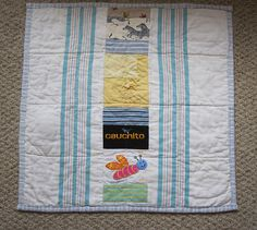 Paul's baby clothes quilt back. The flanking flannel is the baby blanket he was given from the hospital at birth.