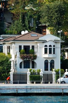 """Yali means """"seashore, beach"""" & is a house or mansion constructed waterside  in Istanbul, Turkey, built with an architectural concept that takes into account the characteristics of the coastal location. The term """"yalı"""" is used primarily to denote the 620 waterside residences, mostly dating from the 19th century, sprinkled along the Bosphorus in Istanbul.  Finely worked wood was the predominant construction material chosen for yalıs, as in traditional Turkish houses."""
