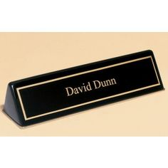 Our Black Desk Name Plate measures x making it perfect for any desk! It is made of black piano finish and has a black and gold engraving plate attached. We will engrave one line of text for free! Black Piano, Black Desk, Desk Plaques, Work Anniversary, Contemporary Desk, Desk Name Plates, Black Stains, Office Accessories, Black Gold