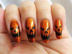 Pumpkin Parade - Halloween Challenge #4: Jack-O-Lanterns. Kleancolor Metallic Mango, Revlon Orange Fizz and Sally Hansen Nail Art Pen in Black/Noir. Click the image for more!
