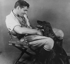 Clark Gable. I love this picture!   From the book: Hollywood Dogs, by Jean-Claude Suares.