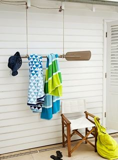 Hanging oar off wall to hold towels. Great lakeside or poolside idea.