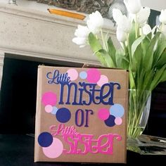 Classy Gender Reveal Party Ideas | Halfpint Design - Little Mister or Little Sister. Gender revealed by helium balloons being released when the box is opened. Standard colors are pink and blue but I dare you to be bold and go for something different!