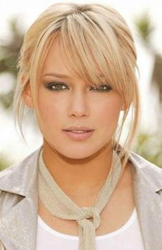 Cute bangs, easy up hair, great color, with eyebrows the right tone so she doesn't look harsh, love her look!~RP~
