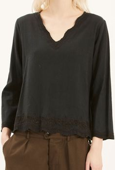 Hand embroidered cotton top. V neckline.