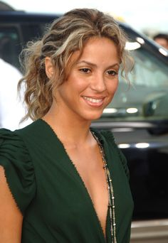 Shakira rarely wears her hair back, but she did at the 2005 MTV Video Music Awards, letting platinum highlights fall out of her darker, messy ponytail.