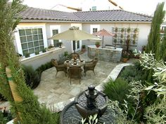This gorgeous patio space, complete with bubbling fountain, used to nothing but gravel.