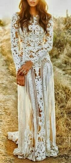 Long sleeve long dress. White. Made out of lace.