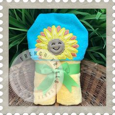Sunflower hooded towel embroidery design.  Applique sewing project idea.