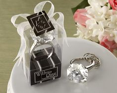 """Snazzy and sophisticated with plenty of glittering facets, this beautiful crystal """"diamond"""" is a perfectly oversized version of the real thing, with enough expertly designed details to set heads shaking! The ring includes several key chain hoops, perfect for keeping all your keys organized. May we suggest these make excellent bridesmaids favors and gifts for #bridalshower guests at your #wedding? Even perfect as #weddingfavors!"""