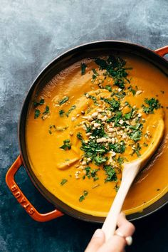 Spicy Vegan Carrot Soup made with coconut milk, onions, carrots, garlic, and curry paste. Easy, vegan, gluten free, awesome.   pinchofyum.com