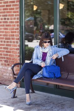 All about a Trench Coat and where it came from. Blue Rebecca Minkoff bag compliments powder blue trench coat and purple sweater - details on the blog at http://redlipstickoptional.com/2015/10/09/100-years-of-a-trench-coat