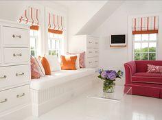 window seat. orange and white