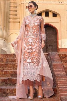 Dazzle everyone around as you walk into a Party wearing this Peach Net Trouser Suit which makes it astonishingly charming. This V neck and Quarter Sleeves garment embellished in stone, sequins and dori work.  Present with Santoon Trouser in Peach Color and Peach Net Dupatta. Dupatta embellished in Stone, Sequins and Dori Work.  This Trouser Suit can be customised up to 44 Inches around the Bust.