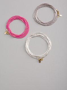 Bracelets:  Japanese glass beads strung on silk thread