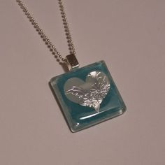 Glass Tile Necklace for Valentine's Day - I love the look of this pendent using foil stickers.