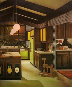 I love the harvest gold with the avocado and dark walnut, but I could live without the fruit and the polka-dots.  Those pendant lamps and that back wall of windows - I want to cook lots of 70's weird looking food in that kitchen.