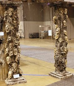 Halloween columns~using as inspiration to redo cemetery arch. Grapevines, moss, GS skulls, bugs, snakes...