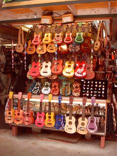 Ukulele display at a gift shop in Waikiki, Hawaii.  #Aqua12staysofchristmas