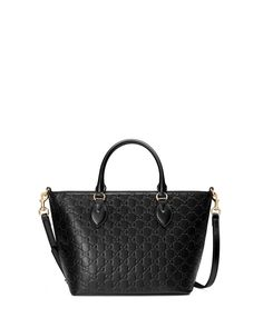 "Gucci Guccissima leather tote bag with golden hardware. Rolled top handles, 4"" drop. Removable shoulder strap, 20"" drop. Zip top closure. Interior, microfiber lining; one zip and two slip pockets. Met"