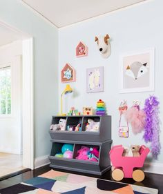play room- displaying kids art in house shadow boxes.