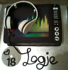 This cake was made for a DJ friend of my daughter's. Headphones made of fondant, equalizer printed on rice paper. Banana cake used, wit...
