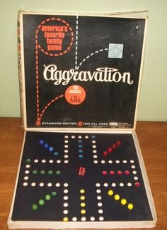 The one I played was on a wooden board and Grandma called it 'marbles.' Still have the board, the marbles, & her dice. Now I play it with the grandchildren.