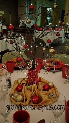 Branch, gold and red ornaments, battery lights, glass vase filled with red bead garland! grandparentsplus.com