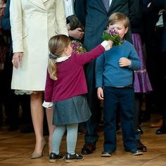 Princess Isabella of Denmark offering her big brother Prince Christian a sniff of her flowers
