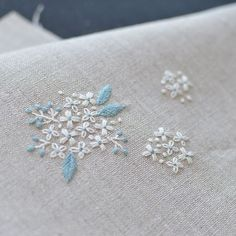 hydrangea? Reeves spirea? I like to embroider small flowers .