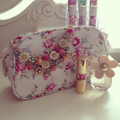 Daisy perfume. YSL lipstick. Floral makeup bag. Floral necklace