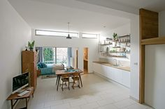 Interior holiday home No59 with '60 s Webe kitchen table and bed and tomado kitchen racks