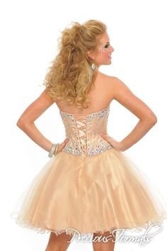 An adorable short flared dress with a curling illusion skirt and a strapless bodice bursting with jewels.
