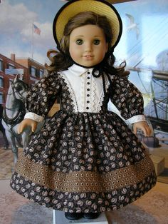 Here is a classic mid-1800s era gown for American Girl dolls, in the colors very typical of the period.  The printed fabrics I used are two cotton reproduction fabrics from a premier reproduction fabric designer, Judie Rothermel.  The date on the selvedges of this fabric say 1850 - 1865.  The styling is very authentic, with the prim collar, v-shaped trimming on the bodice, sloped shoulders, and wide, full sleeves.  I have trimmed the bodice and cuffs with a lustrous cluny lace, the front…