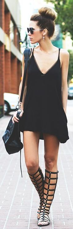 Street style   White knit top, leather shorts, statement necklace and strapped heels