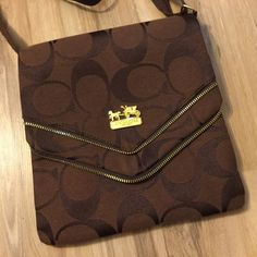 Brown Monogram Crossbody Perfect condition!! Comes from a smoke-free and pet-free home. PLEASE DO NOT make an offer or buy this item or ANY of my items if you are just going to cancel the order or expect me to cancel the order. That wastes my precious time! ;)  I posh for fun! THANKS!!! Bags Crossbody Bags