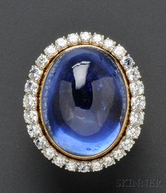 Sapphire and Diamond Ring, bezel-set with a high-domed cabochon sapphire measuring approx. 26.50 x 21.50 x 15.00 mm, 14kt gold mount, with a removable platinum and full-cut diamond frame, approx. total diamond wt. 3.00 cts.