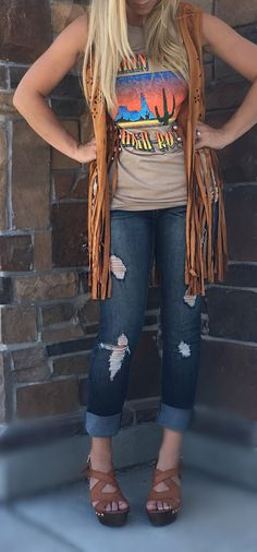 Need something to spice up your closet? You can never go wrong with a bit of fringe in the summer! This vest comes in Rust or Tan. These run true to size!