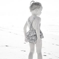 This pretty playsuit is built for comfort and ease. It has elastic straps at the back so it's comfy on little shoulders anf have room to grow, it also means the
