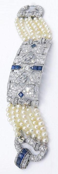An Edwardian platinum, diamond, sapphire and natural pearl bracelet, circa 1910. #Edwardian #bracelet