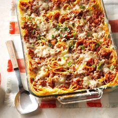 Favorite Baked Spaghetti Recipe -This yummy baked spaghetti casserole will be requested again and again for potlucks and family gatherings. It's especially popular with my grandchildren, who just love all the cheese. —Louise Miller, Westminster, Maryland