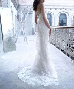 Love the soft pedals adorning the gown