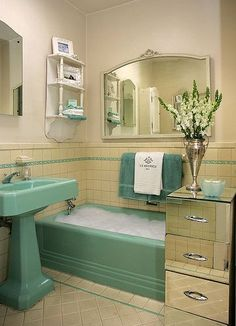 """We popped by an open house happening up the street, and before the agent showed us the bathroom, she said warningly, """"It needs a LOT of love...!""""  But the bathroom actually reminded us of Lynn and Leif's beautiful house tour with the matching lavender tub-sink-toilet combo and black-and-white Art Deco tiles."""