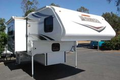 """2016 New Lance 855S Truck Camper in California CA.Recreational Vehicle, rv, FOR SALE: THIS IS OUR 2016 LANCE 855S TRUCK CAMPERTruck Campers / Acampo, CASOME OF THE FEATURES INCLUDE: (1) SLIDE OUT W/REMOTE CONTROL, AIR CONDITIONING W/WALL CONTROL, REAR DOOR AWNING, SLIDE OUT AWNING, BACK UP CAMERA W/WIRELESS MONITOR, KEYLESS ENTRY W/KEY FOB, ROOF RACK SYSTEM, PASS THROUGH WINDOW (REMOVABLE, SOLAR PANEL, 24"""" LED TV 12 VOLT, SECOND BATTERY COMPARTMENT, AM/FM/DVD STEREO W/INT & EXT SPEAKERS…"""
